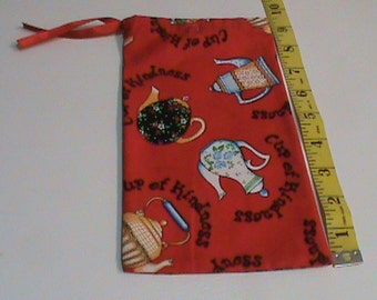 Cup of Kindness Tepots on Red Fabric