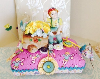 Pincushion Vintage Boy With Flower Cart Figurine