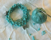 Boho wrap bracelet Turquoise stacked fiber bracelet Vintage MOP button Angel wing and Puffy heart dangles