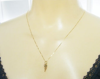 14kt gold wing necklace delicate and minimal