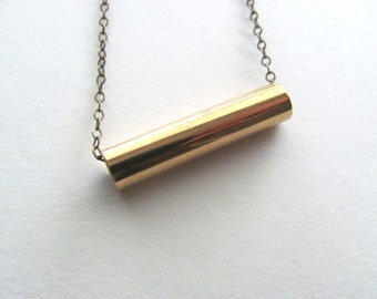 Gold tube pendant necklace on delicate antique brass chain, gold bar necklace