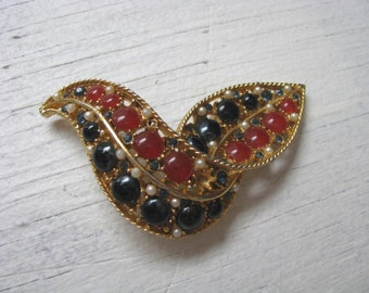 Vintage Coro gold tone bird brooch pin with red white blue stone