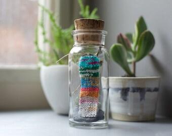 Mini handwoven weaving in a bottle
