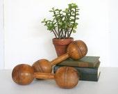 Pair of antique wood dumbbells. Wooden, rustic, decor, decorative, exercise equipment, natural wood.
