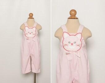 Vintage 80s happy cat overalls - baby girl's pink corduroy bibs