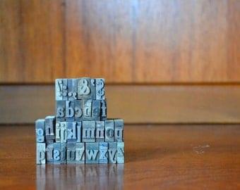 vintage lowercase cheltenham condensed bold metal type set