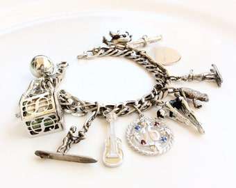 vintage Sterling silver charm bracelet loaded  with charms collectible pieces