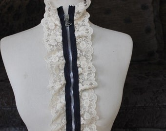 Cute zipper    applique  with  ivory  color ruffled  1 pieces listing 17 1/2  inches long 5 inches wide