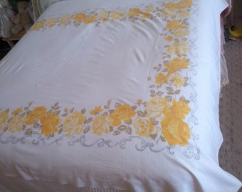 Vintage white tablecloth with yellow roses