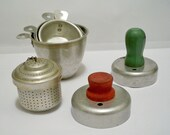 Vintage lot of kitchen collectibles - Measuring cups - Biscuit Donut cutters wood handles red & green - metal tea infuser - cheesegrits