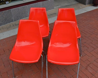 Set of 4 ORANGE mid-century fiberglass chairs by Krueger Metal Products of Green Bay Wisconsin