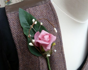 Pink rosebud boutonniere with diamonte and pip berries