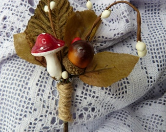 Woodland wedding toadstool boutonniere
