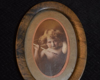 Vintage Picture of Child holding Arrow