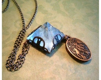 Pyramid and filigree necklace with decorative charm
