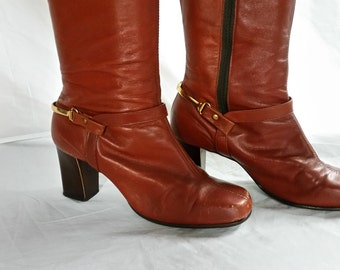 Red leather Vintage knee high boots with metal bar around heel