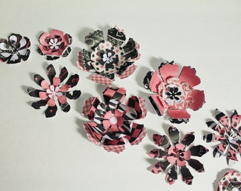 Eleven handmade layered flowers with Paris themed paper pink black polka dots