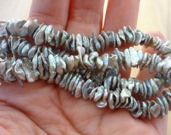 Center drilled silver keshi pearls 6-9mm 1/2 strand