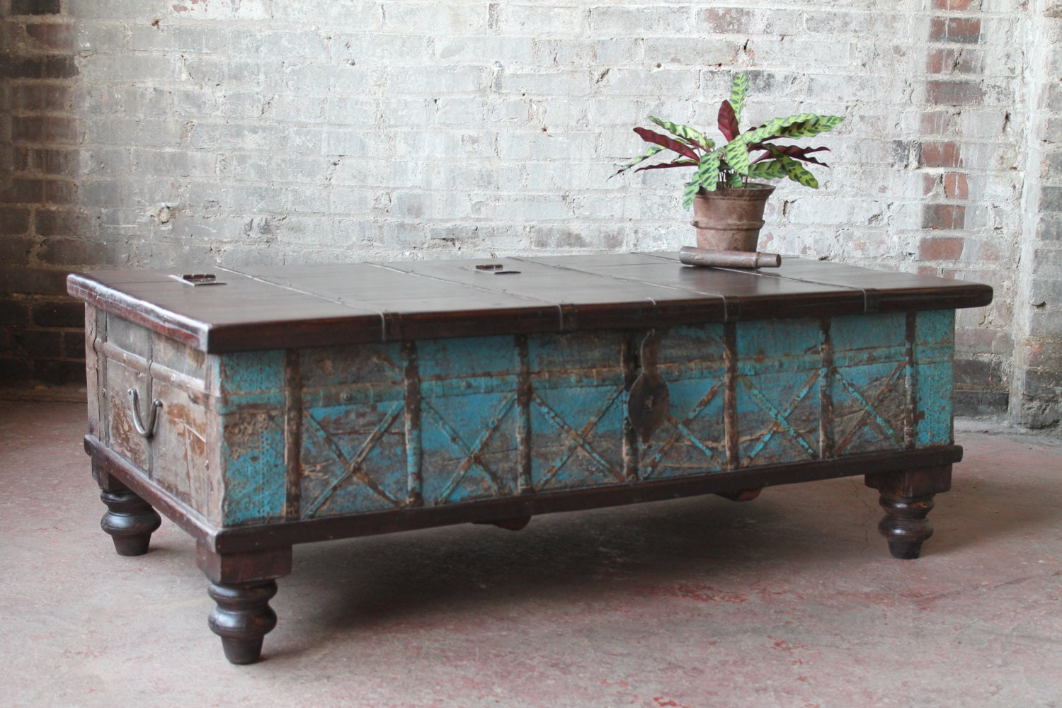 Reclaimed trunk coffee table rust and jade green iron and Indian trunk coffee table