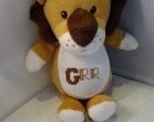 Brown Stuffed Animal Lion with white cross stitch bib....GRRRRRRR, tan, white, baby, child, stuffed animal, toy