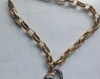 10K yellow gold link bracelet with 10K diamond heart charm    VJSE