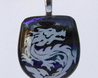 White enamel dragon on dichroic glass pendant.