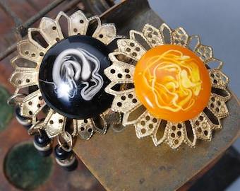 Set of 2 Vintage brooches, metal with plastic, black and yellow