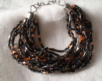 Handmade Beaded Bracelet, Eight Strands, Rich Brown and Gold Beading