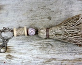 tassel keychain with organic banana fiber a a wooden spool, beautiful natural bag charm, sustainable statement jewelry for tree hugger