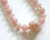 vintage pale pink glass beaded necklace with a large floral bead in the center~ retro antique pink necklace