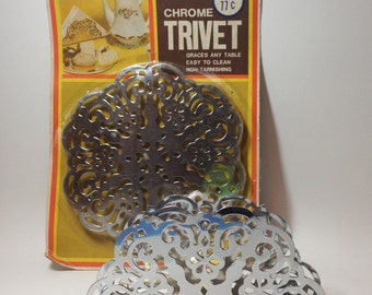 Chrome  trivet and napkin holder from the 1970's. Brand new in package never used.