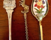 THREE SOUVENIR SPOONS from different ports.  Excelllent educational tool.
