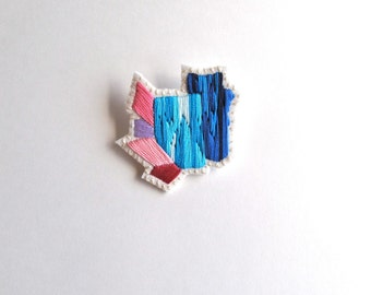 Abstract mineral brooch gem inspiration hand embroidered in ombre blues with pink and lavender on cream muslin and cream felt
