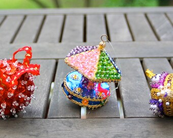Three pin and sequin ornaments