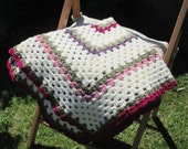 Baby blanket crocheted with rows of coloured flowers