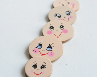 "4 Cute Doll Face Size 1.50"" and 1 Small Doll Face Size 1 1/8"""