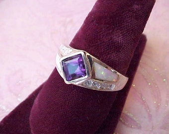Very Pretty and Unusual Sterling Silver Ring with Deep Amethyst Colored Stone