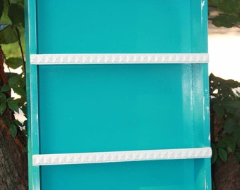 Turquoise wall shelf