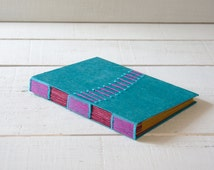 hand stitched books!  coptic bound notebook, sketchbook or photo- book