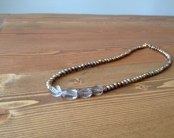 Bronze Pearl and Smokey Quartz Necklace sits just below the throat