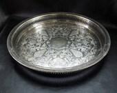 Ornate round platter, vintage silver plated serving tray, embossed floral motif, openwork detail