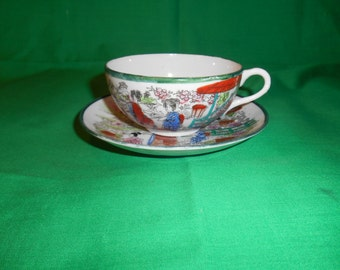 One (1), Egg Shell Porcelain, Geisha Girl Tea Cup & Saucer, Green Trim.