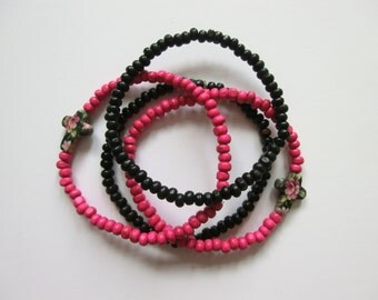 Pink/Black Wood Stretch Bead Bracelet (Set of 4)- Pink/Black Wood with Floral Howlite Stone Cross
