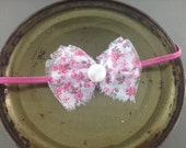 Vintage fabric bow with vintage button center