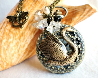 Swan pocket watch pendant, pocket watch with swan mounted on front cover.
