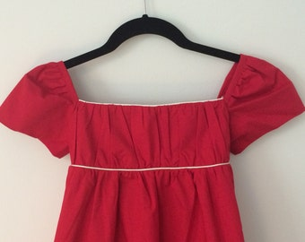 Girl's Organic Cotton Holiday Red Empire Waist Dress with white piping, by Amuse Me Shop, M/L