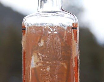 Early Old OWL DRUG Co antique bottle w/ Spirits of Camphor label and pic of Owl molded in the glass - 100 years old.