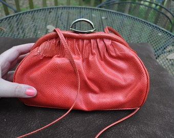 Etra Red Leather clutch purse with shoulder strap, perfect for a night on the town