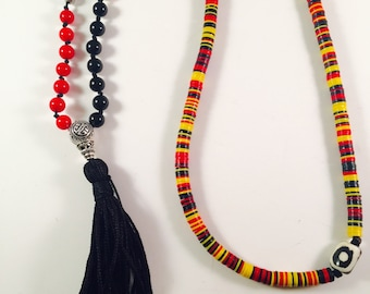 Knotted Necklace with African Vinyl discs, Black Onyx, Red Coral, Black and White Bone bead and handmade tassel
