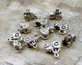 Ten (10) Pewter Farm Tractor Charms - 1906